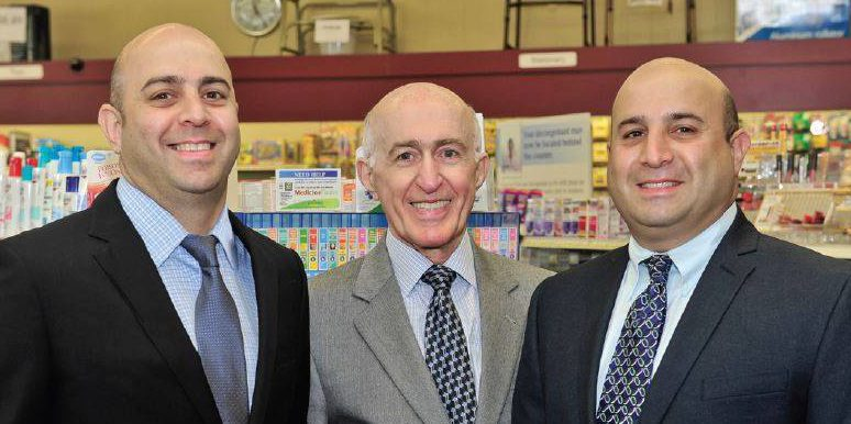 Raied and Saad with their father, Ramzi Dinno, who is also a pharmacist.