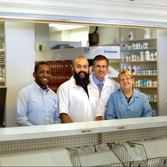 Theatre Pharmacy staff at the prescription counter