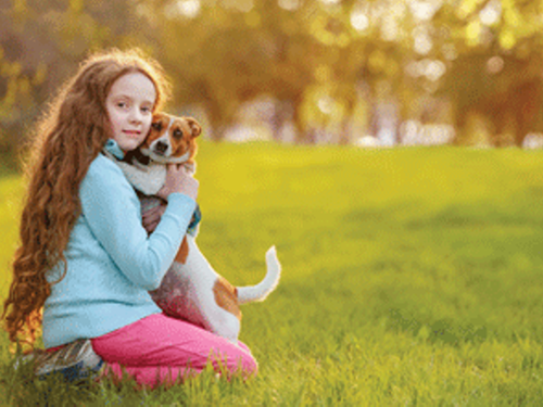 Girl with dog in her arms
